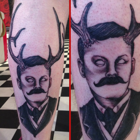 eckel stag man horns black and grey moustache tattoo old new school