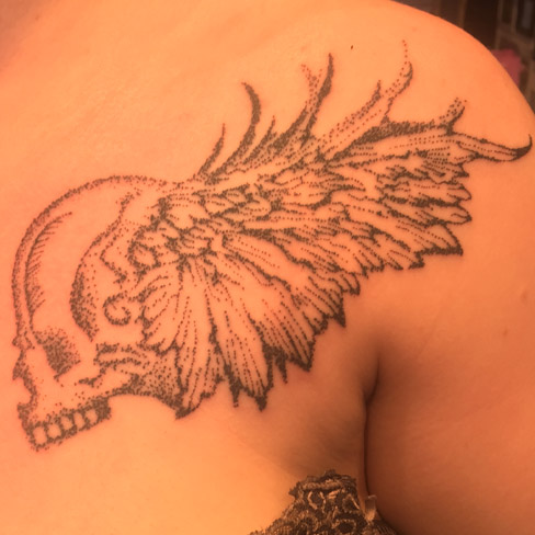 dotwork winged skull colchester essex reds tattoo chest tattoo